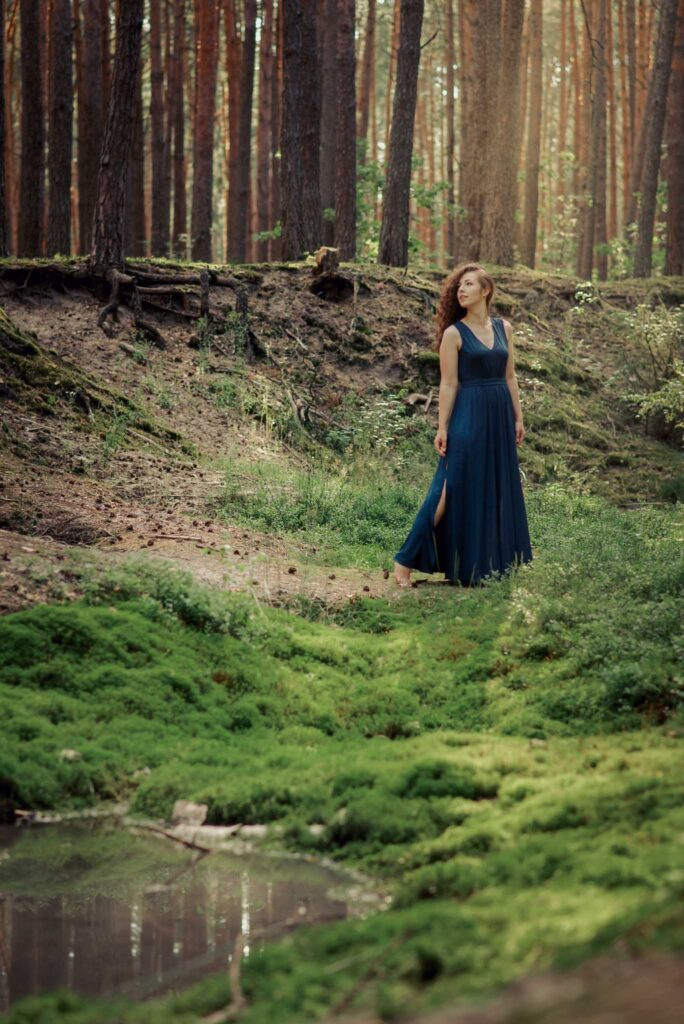 lady in blue dress in a forest